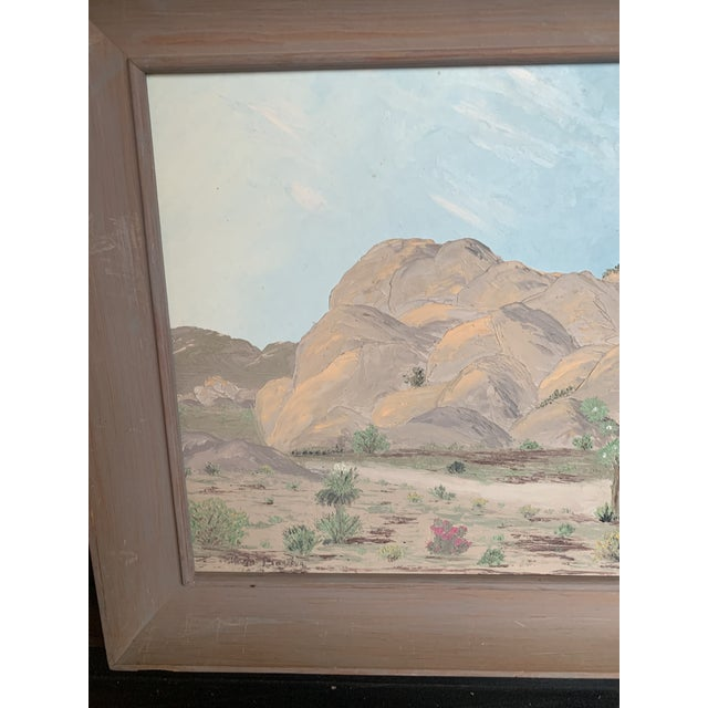 Southwest landscape painting with a muted color motif in frame.