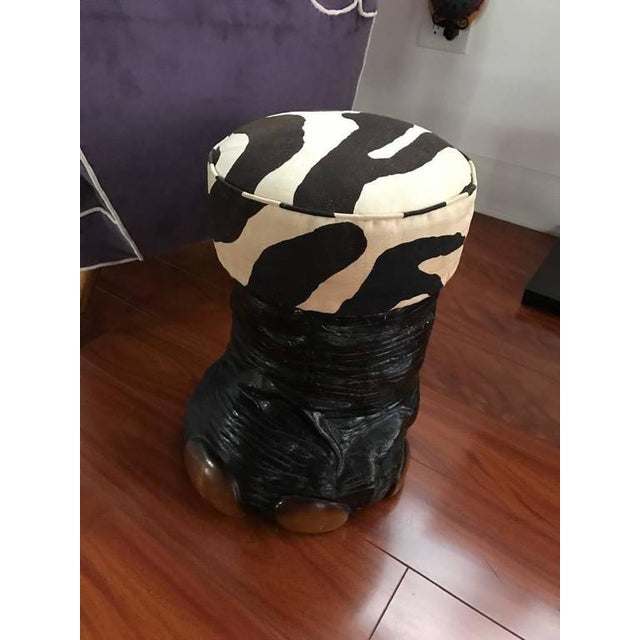Mid-Century Modern faux elephant foot base with faux zebra print upholstered seat.