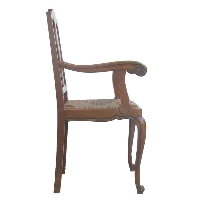 Add a little warmth and comfort to your decor with this lovely Aesthetic Movement / Arts & Crafts arm chair in oak with a...