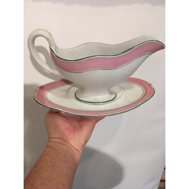 This gravy boat sits on a matching tray (plate). It is a nice large size with fun colors. The age shows with some wear to...