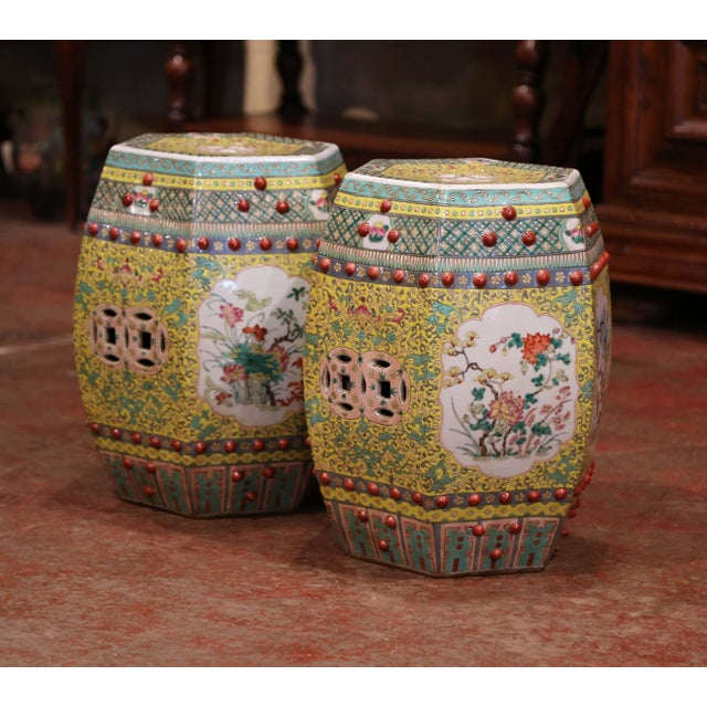 This pair of colorful vintage garden stools was created in China, circa 1960. The hexagonal porcelain seats are pierced on...