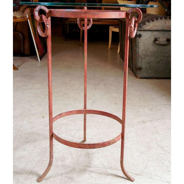 Pair of wrought iron stands with glass tops in neoclassical form. Useful side tables or accent pieces.