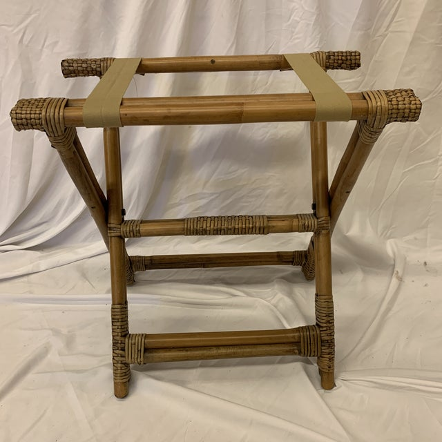 Really great and solid bamboo folding luggage rack. I mention tray stand because it would be great in a bathroom or small...
