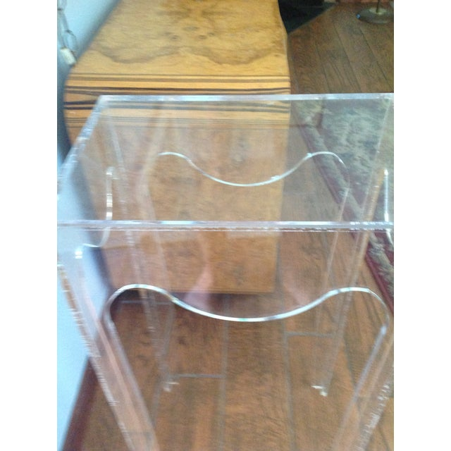 Vintage acrylic table plant stand. Clear see thru ghost like table with sculpted scalloped edges. Great for plants or...
