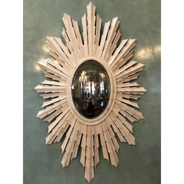 Italian bone unique oval shaped sunburst mirror with convex glass.