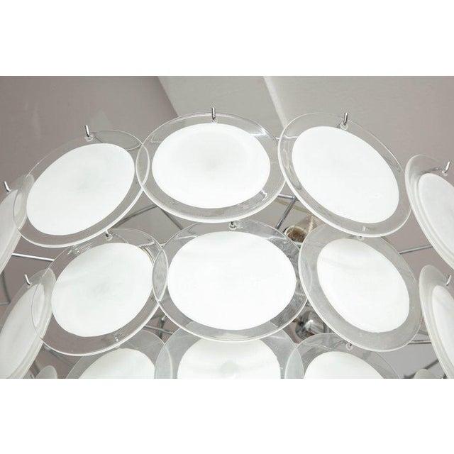 Murano white glass disc chandelier.