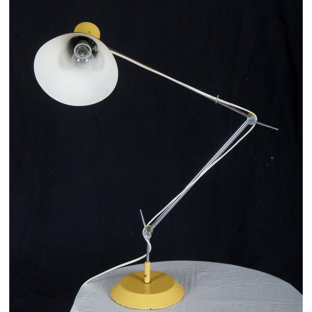 This table lamp was designed by Josef Hurka and produced in Czechoslovakia by Napako during the 1970s. The articulated...