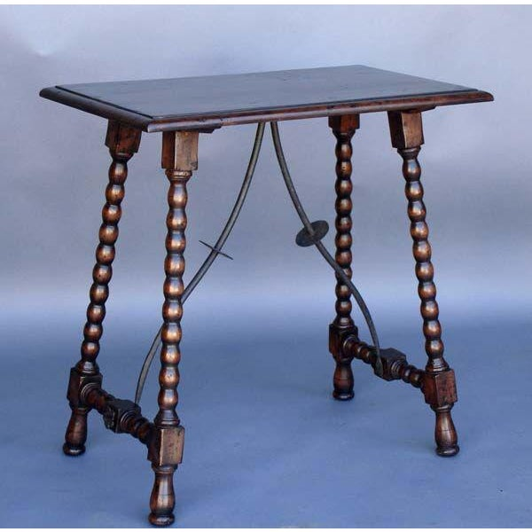 Custom Classic Spanish bobbin side table with iron supports. Shown here in walnut with light distress. Made by Dos Gallos...