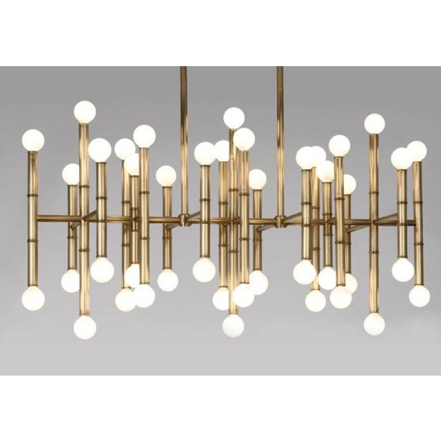 Globes of light pop from a bamboo-like frame, giving the Robert Abbey Meurice Rectangular Chandelier designed by Jonathan...