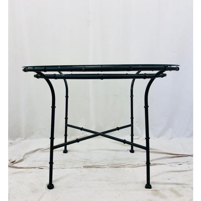 Stunning Vintage Mid Century Chinese Chippendale Faux Bamboo Shaped Metal Table with Round Glass Top. Fabulous as is in...
