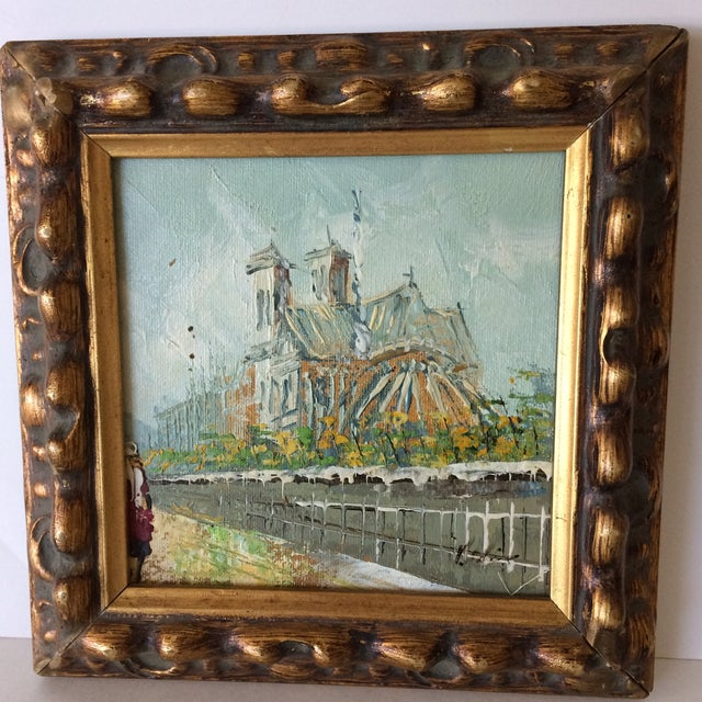 A lovely little professionally framed piece of art depicting a back view of Notre Dame Cathedral in Paris, France....