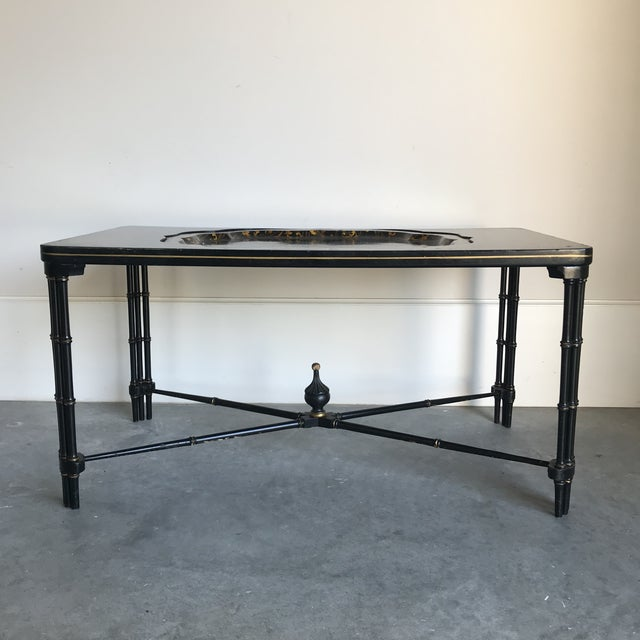 English Regency style black lacquered coffee table with decorative floral design and inset in a black lacquered and gilt...