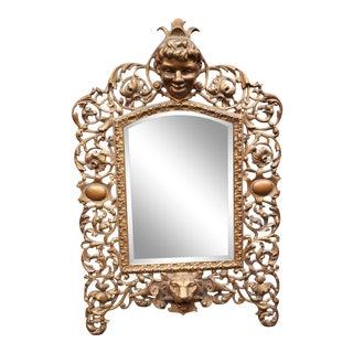 1890 American Art Nouveau Boy, Lion, and Floral Motif Gilt Metal Beveled Glass Mirror For Sale
