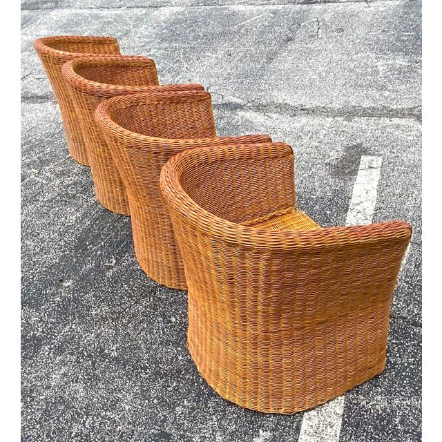 Stunning rattan barrel chairs. This is a set of four. Beautiful barre shape with a slight flare at the bottom. 70s roll...
