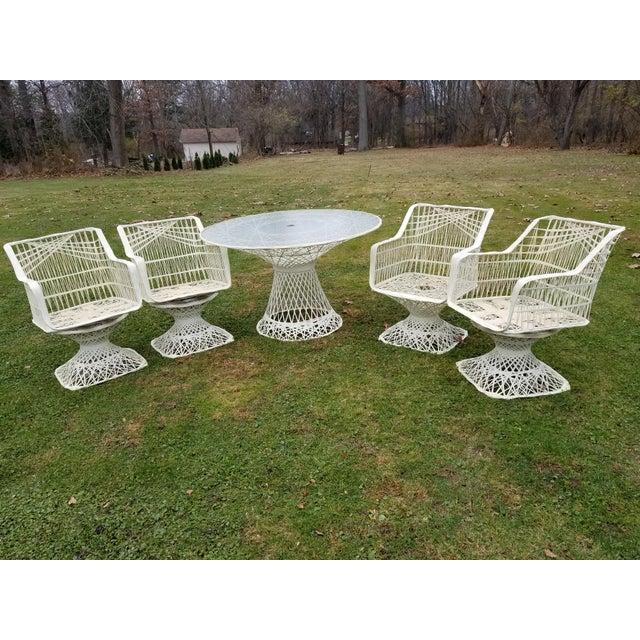Russell Woodard Spun swivel Fiberglass style Chair Table Patio Set 5 piece Spun metal plastic coated table Measures about...
