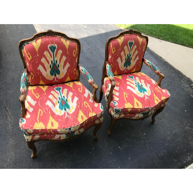 Pair of beautiful vintage Baker Furniture chairs done in soft cotton, bright IKAT pattern upholstery. Completely down...