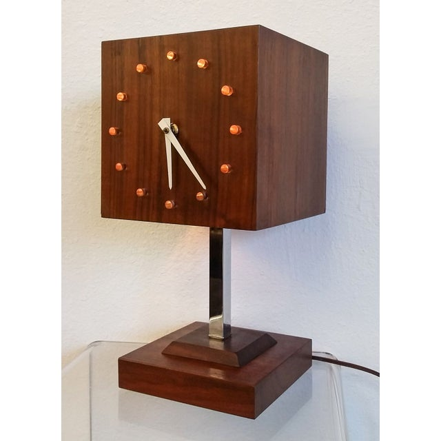 A gorgeous piece of mid mod design~ a walnut cube clock! Plug the clock in and it keeps good time; flip the switch on the...