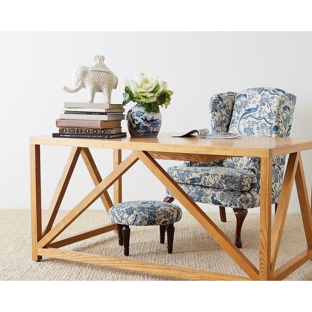 Chic Mid-Century Modern oak writing table, library table or desk featuring an open architectural design. Crafted from...