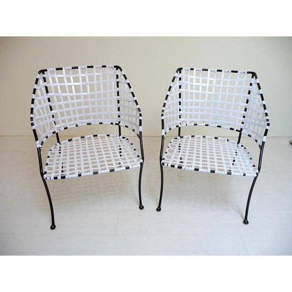This is a rare, early pair of Brown Jordan patio chairs from the 1950s. They have lovely, graceful arms and legs -- very...