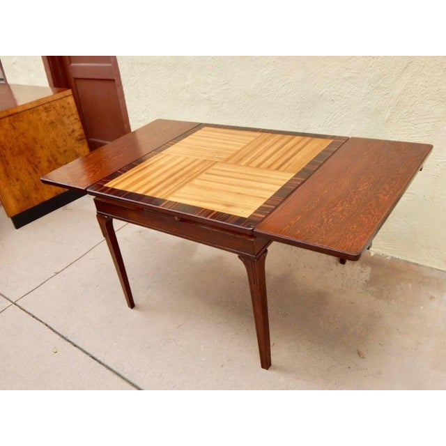 Swedish Art Deco extendible side table by Eric Chambert, circa 1930. Rendered in birch wood and zebrino with parquetry top...