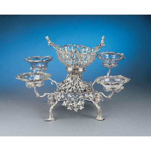 A remarkable Georgian sterling silver epergne by London silversmiths John Lawford and William Vincent. The entire epergne...