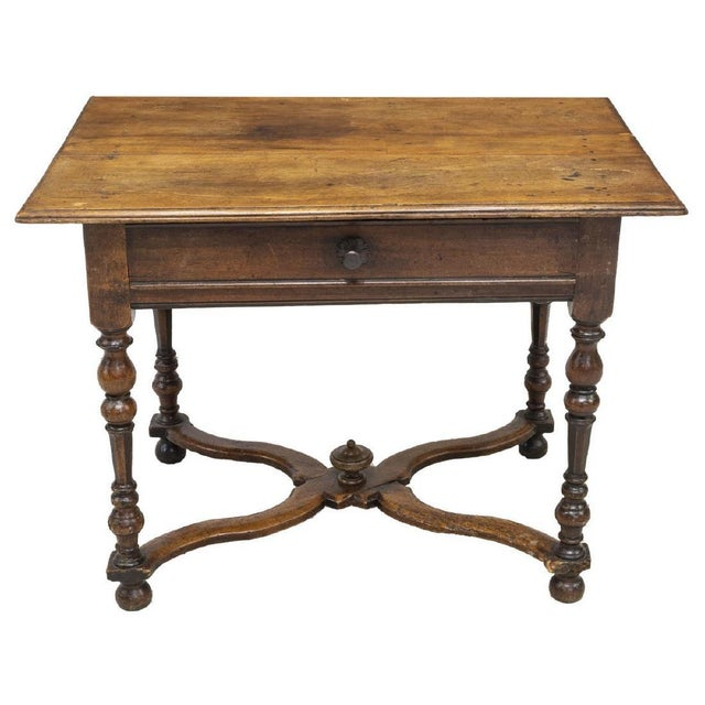French Henri II style walnut writing desk from the late 18th/early 19th c. This desk consists of four planks of walnut...