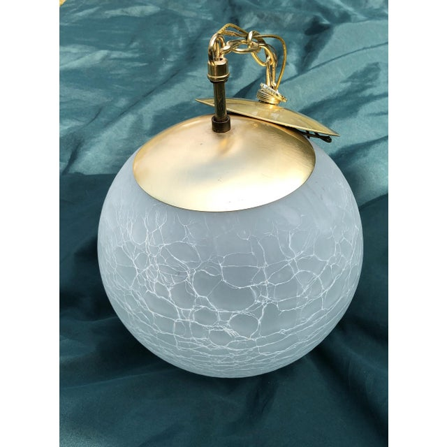 This piece is a vintage Moe Light, a crackled, etched, glass, pendant, globe lamp, produced by Thomas Industries Inc. The...