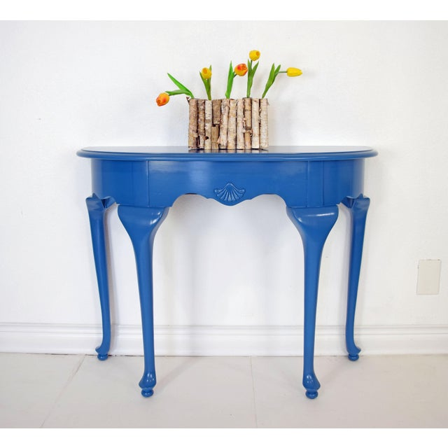 Blue entry table refinished in satin Marea Baja by Sherwin Williams.