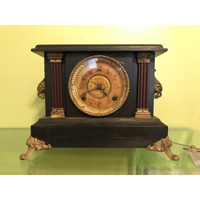 Beautiful antique mantle clock by Wm. L. Gilbert Clock Co. (Instead, Connecticut); 1911. Black wood case with hand carved...