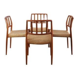 Niels Moller for J.L. Møllers Møbelfabrik Model #83 Teak Dining Chairs with Danish Cord - A Set of 4, Denmark For Sale