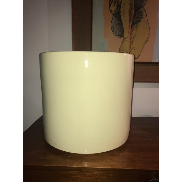"A pair of enormous Gainey Pottery, Laverne California, ceramic planters. Shiny purple glaze. Measures 31.5"" diameter."