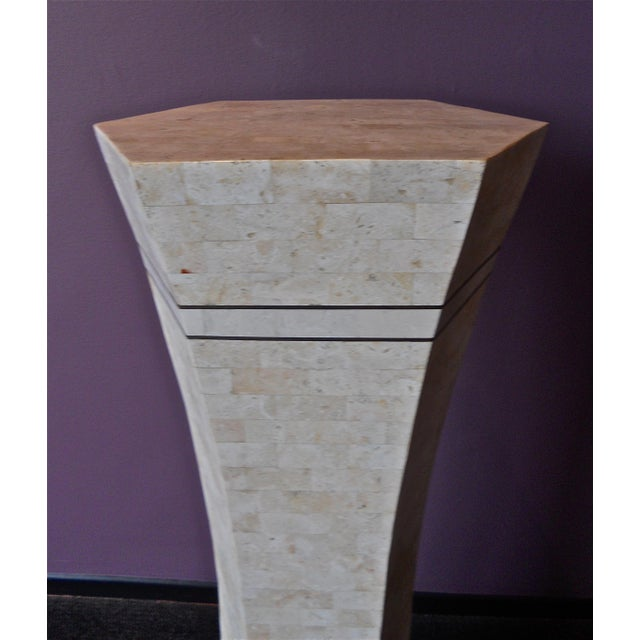 This is a lovely tesselated marble and brass accent sculptural pedestal made in the manner of Maitland -Smith. The gentle...