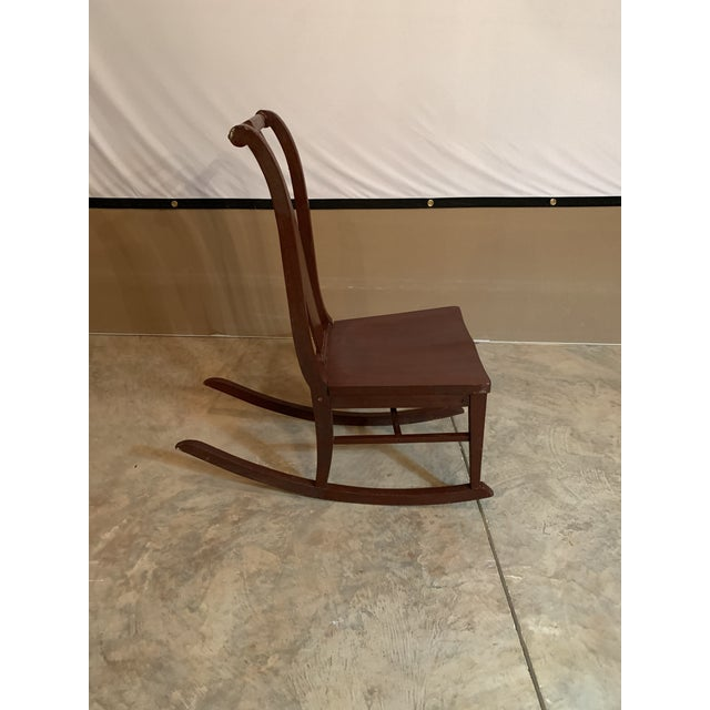 Early 20th Century Antique Carved Scrolled Splat Back Solid Wood Brown Painted Children's Rocking Chair For Sale - Image 5 of 13