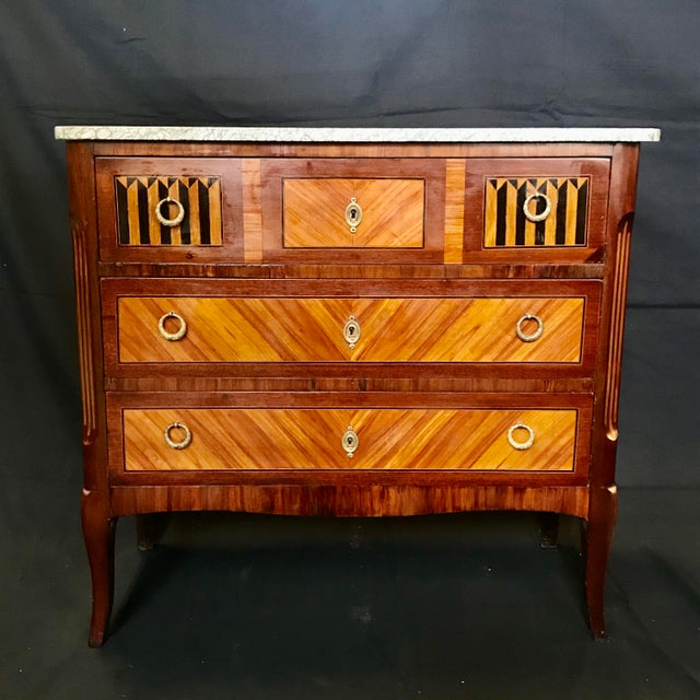 Absolutely beautiful walnut French Louis XVI style marquetry inlaid petite commode with marble top and intricate ebony...