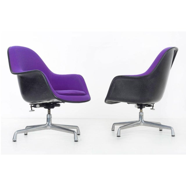 EC-178, upholstered in original Girard Hopsak with black shells. Chairs tilt and swivel.