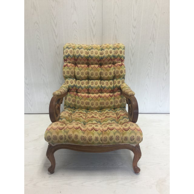 Unusual, tufted, slant back chair with carved wood arms. Very comfortable and very unique accent for your room.