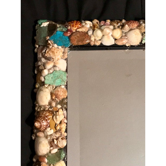 Spectacular mirror with custom designed frame featuring beautiful oceanic elements of seashells and genuine turquoise...