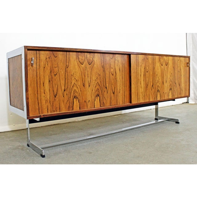 Offered is a mid-century modern credenza, designed by Richard Young for Merrow Associates. It is made of rosewood with...