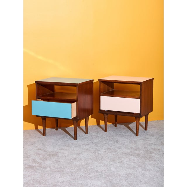 Vintage circa 1960s Danish walnut nightstands with pink and blue laminate tops and drawers. Perfectly mismatched pair of...