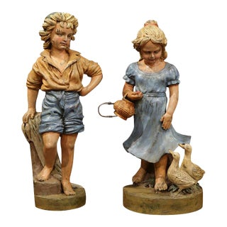 Mid-20th Century French Iron Painted Statues of Boy and Girl With Ducks - a Pair For Sale