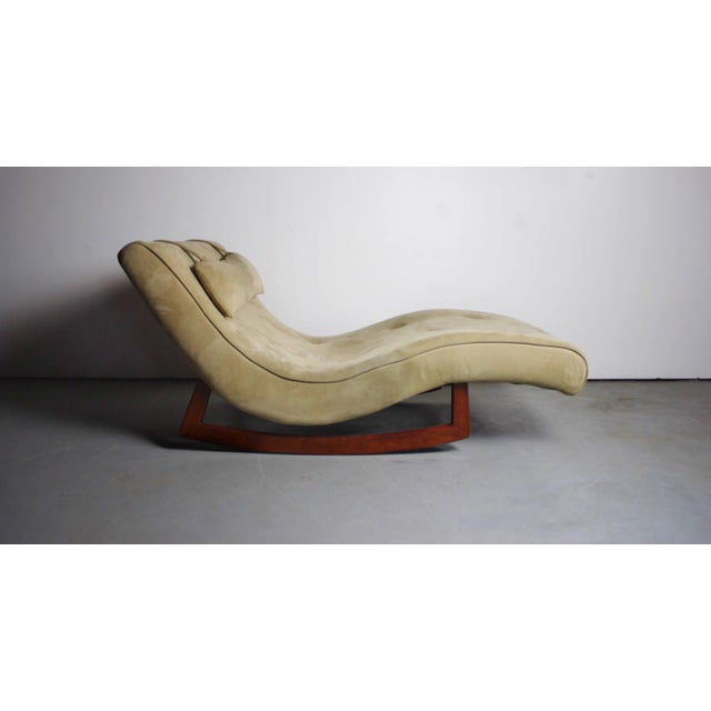 A beautiful wave chaise lounge chair designed in the manner of Adrian Pearsall in a tan microfiber material. Overall, an...
