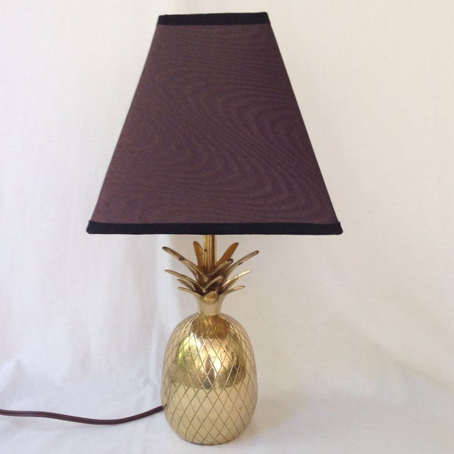 Add some Hollywood Regency glam to decor with this vintage brass lamp with an etched pineapple as the base. It has an...