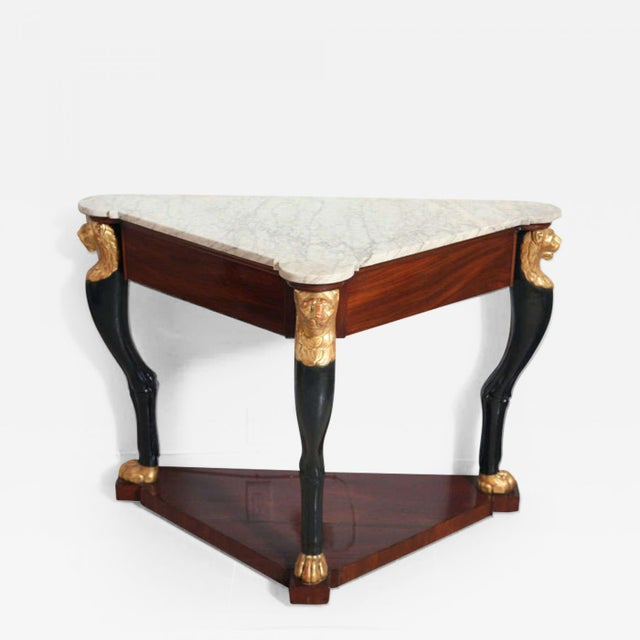 The marble top over a mahogany frieze, the legs in the form of animal legs with lion paw feet and heads, over a mahogany...