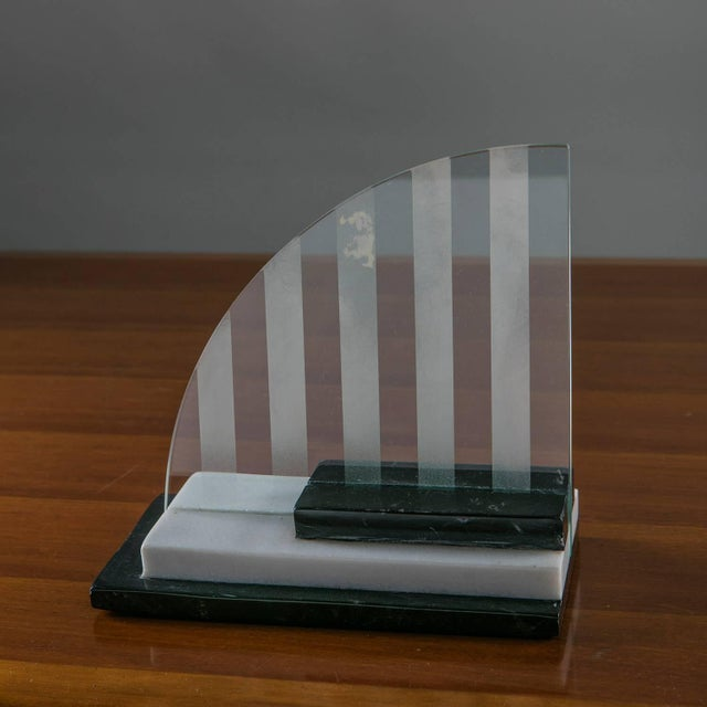 Italian marble picture frame / centerpiece manufactured by Skipper. Three marble slabs host the curved shape glass with...