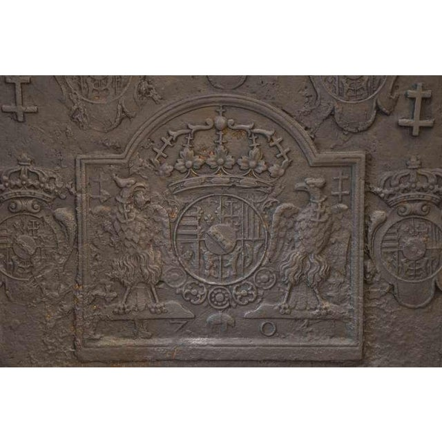 Large French fireback from the 18th century, showing coat of arms of the Duke of Lorraine. This fireback is dated 1704....