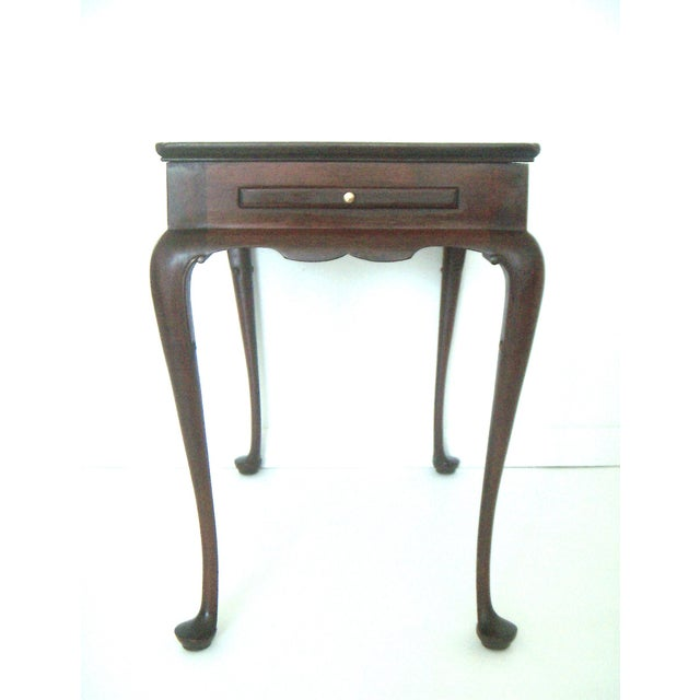 A classic. Made by the high end furniture maker Biggs of Richmond, VA, a Pembroke style tea or side table with two pull...