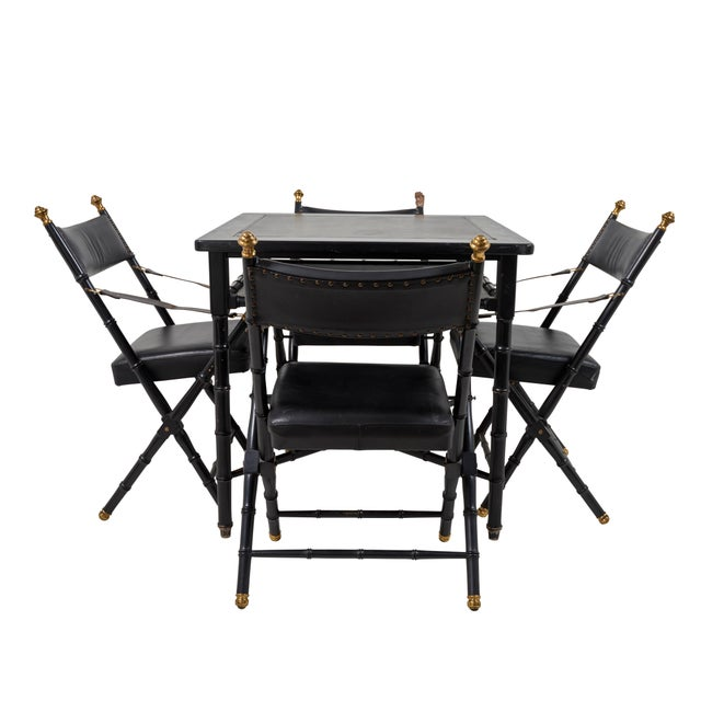 This listing includes four faux bamboo & leather campaign chairs and a game table. The chairs include brass detailing, and...