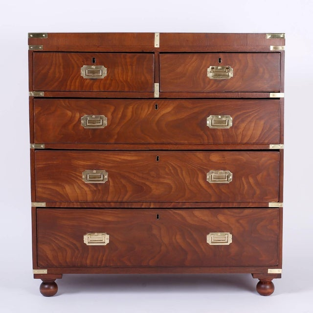 Handsome and historically significant Campaign chest of drawers crafted with exotic grained tropical mahogany on the...