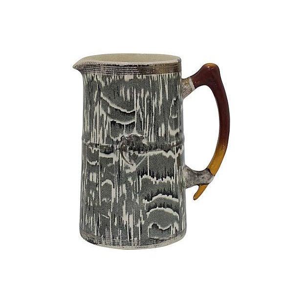 1930s Arthur Woods silver shield faux-bois pattern jug with antler handle. Maker's mark on underside. Light wear, crazing,...