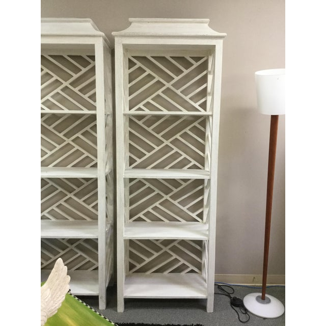 This is a lovely simplistic accent etagere with open shelves in a whitewash finish. The open shelving beautifully displays...